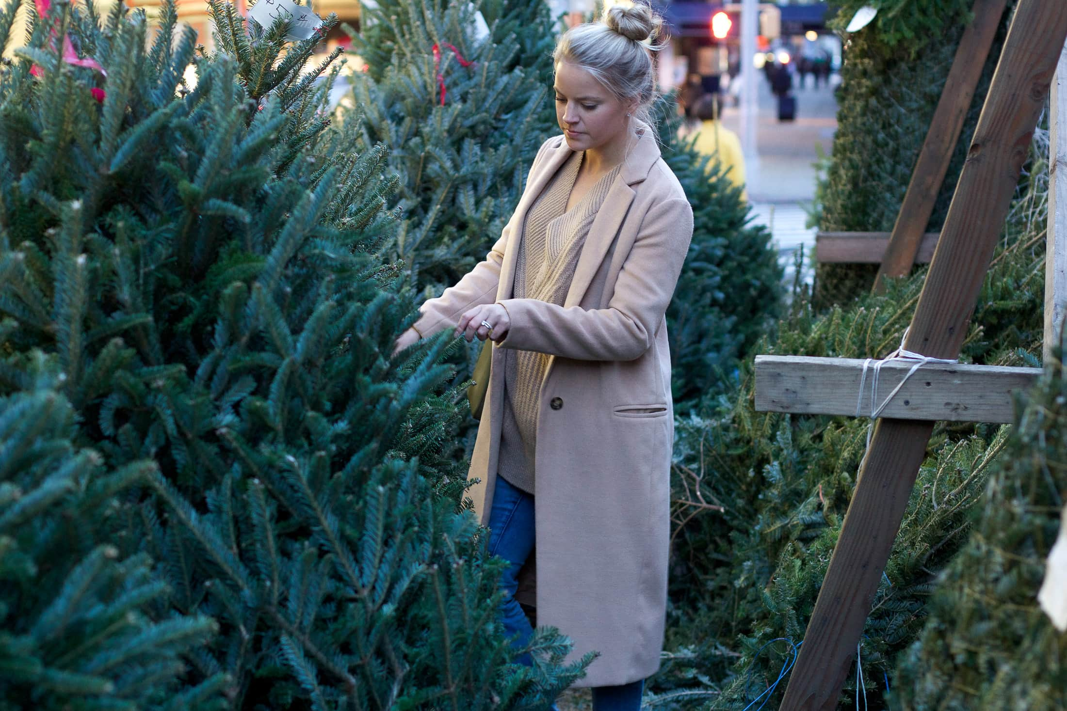 christmas trees in new york city, top knot, long coat
